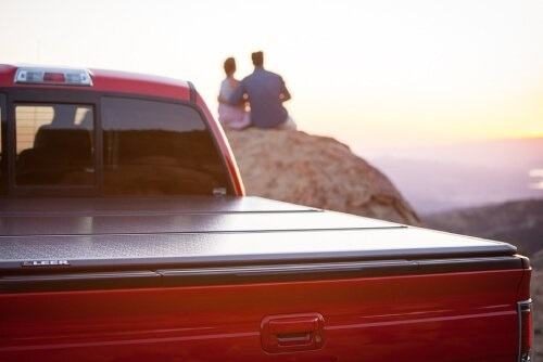 Couple With Truck Enjoying In Sunset